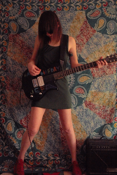 Colleen Green playing Guitar