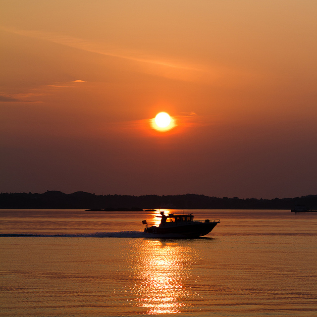 Boat at sunset by @TimOve on Flickr